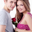 Beautiful smiling couple with red rose. Valentine's day — Stock Photo