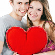 Beautiful smiling couple with red heart. Valentine's day — Stock Photo