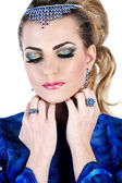 Young woman in blue dress with bright make up and evening hairst — Stock Photo