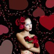 Beautiful girl with red roses in her hair.Valentine's day — Stock Photo #22481287