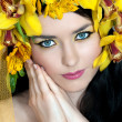 Young beautiful woman with yellow wreath of orchids — Stock Photo