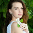 Beautiful girl with flower — Stock Photo #22524997