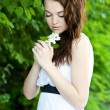 Beautiful girl with flower — Stock Photo #22525017