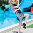 Attractive fashion blonde girl in dress near the swimming pool — Stock Photo