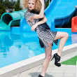 Attractive fashion blonde girl in dress near the swimming pool — Stock Photo #22525049
