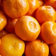 Bunch of fresh mandarin oranges on market — Stock Photo