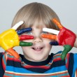 Five year old boy with hands painted in colorful paints ready fo — Stock Photo #22728533