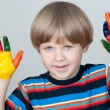 Five year old boy with hands painted in colorful paints ready fo — Stock Photo #22728535
