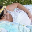 A pregnant girl in a field of flowers — Stock Photo #22729905
