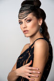 Fashion model with beautiful hairstyling and makeup, pastiche Egypt — Stock Photo