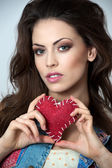 Fashion photo of young sensual woman in jeans. Valentine's day — Stock Photo
