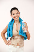 Sports woman drinks wate — Stock Photo