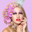 Portrait of beautiful woman with stylish makeup and pink flowers - Stock Photo