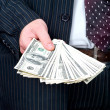 Money in the hand of businessman — Stock Photo
