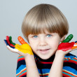 Five year old boy with hands painted in colorful paints ready fo — Stock Photo #22730449