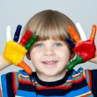 Five year old boy with hands painted in colorful paints ready fo — Stock Photo #22730455