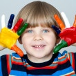 Five year old boy with hands painted in colorful paints ready fo — Stock Photo #22730465