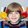 Five year old boy with hands painted in colorful paints ready fo — Stock Photo #22730469