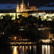 The Prague Castle and the Charles Bridge at dusk in Prague, Czec - Stok fotoğraf
