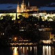 The Prague Castle and the Charles Bridge at dusk in Prague, Czec - Stock Photo