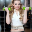 Portrait of fitness woman working out with free weights in gym o — Stock Photo