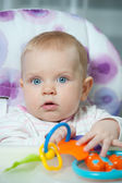 Little baby girl playing with teething toy — Stock Photo
