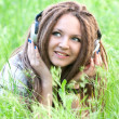 Pretty girl with dreads listening to music — Stock Photo #22766488