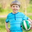 Little sportsman with a ball in the park — Stock Photo