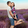 Young couple playing around in the lavender fields — Stok fotoğraf