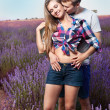 Young couple playing around in the lavender fields — Stock Photo #23091798
