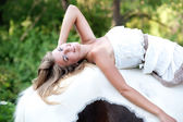 Beautiful young woman with a horse outdoor — Stock Photo