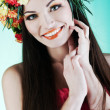 Stock Photo: Young beautiful woman with yellow wreath of carnations