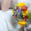 Beautiful colorful wedding bouquet in bride hand - Stock Photo