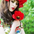 Beautiful woman with red flower wreath. Russian style — Stock Photo