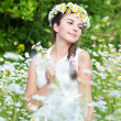 Beautiful woman enjoying daisy field, pretty girl relaxing outdoor, having fun, holding plant, happy young lady and spring green nature, harmony concept — Stock Photo #25905919