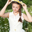 Beautiful woman enjoying daisy field, pretty girl relaxing outdoor, having fun, holding plant, happy young lady and spring green nature, harmony concept — Stock Photo #25906069