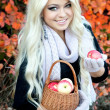 Smiling woman in autumn park — Stock Photo #29953615