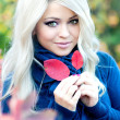 Smiling woman in autumn park — Stock Photo