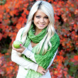 Portrait of beautiful young woman outdoors in autumn — Stock Photo