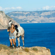 Стоковое фото: Beautiful girl with the horse on the sea shore. Horsewoman