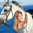 Beautiful girl with the horse on the sea shore. Horsewoman — Stok fotoğraf