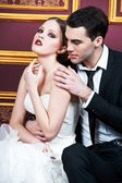 Fashion bride and groom on their wedding celebration — Stock Photo