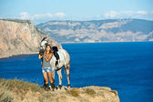 Beautiful girl with the horse on the sea shore. Horsewoman — Stock Photo