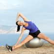 Young happy woman doing fitness exercises on the ball — Stock Photo