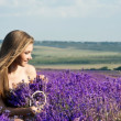 Beautiful girl on the lavender field — Stock Photo