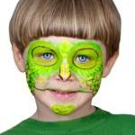 Little boy making face painting. Halloween.Chameleon — Stock Photo