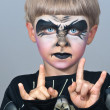 Little boy making face painting. Halloween — Stock Photo
