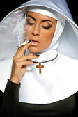Sexy nun. Halloween. Nun smoking — Stock Photo