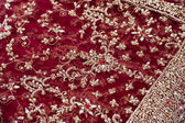 Closeup of red and golden embroidery on Indian saree — Stockfoto