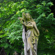 Sad angel statue on old cemetery — Stock Photo #49650439